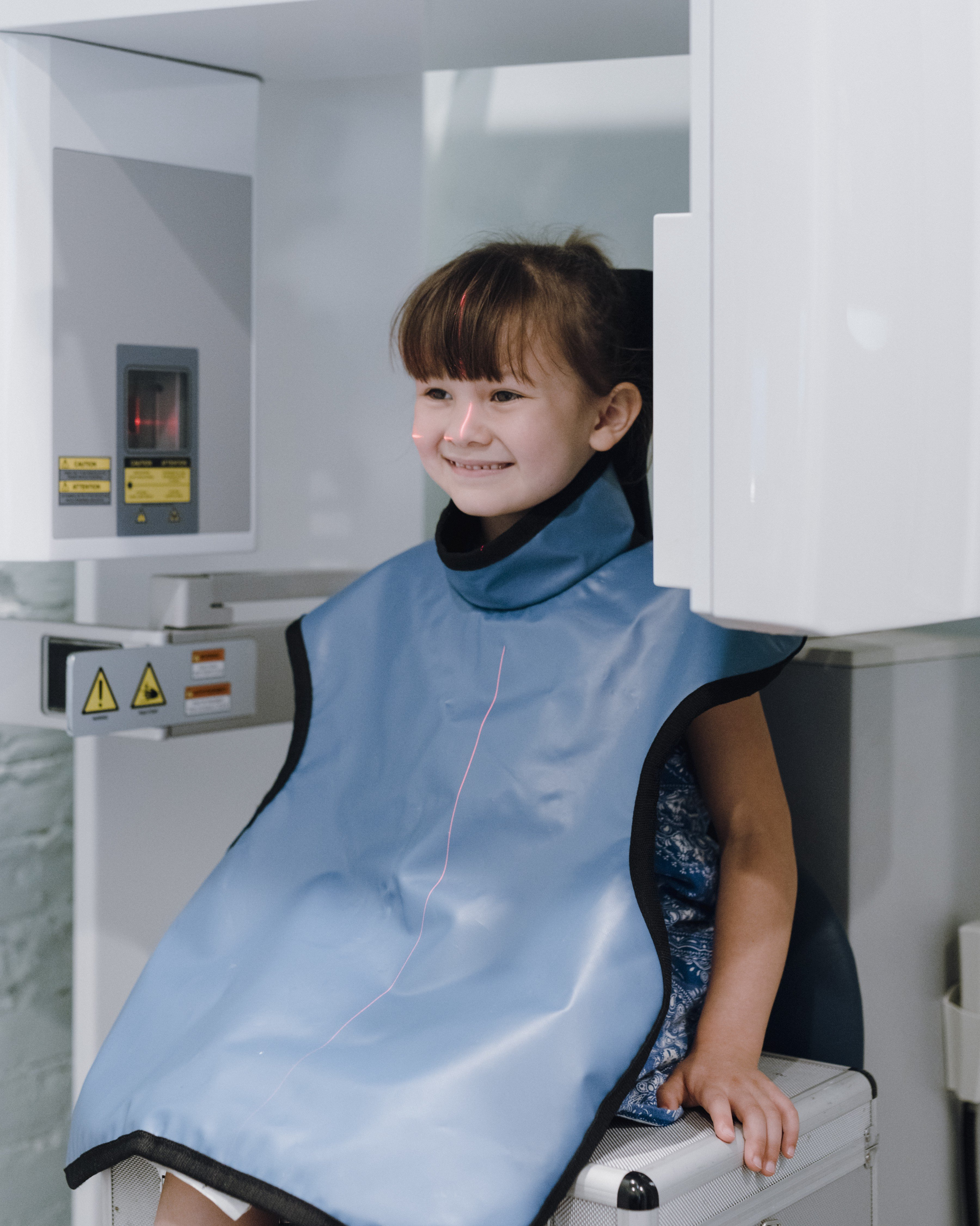 A child getting 3D x-rays at Dr. Boyd's office. To Boyd, any time you see crowding or potential problems on the horizon, it's a signal to expand the mouth now. Photo by Lyndon French