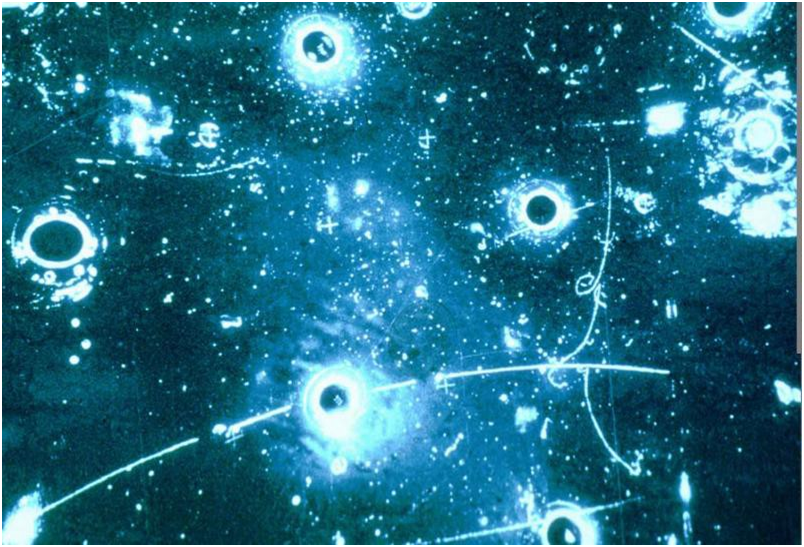 Cloud chambers, like shown in this image, reveal the presence of subatomic particles. The lines that appear in the chamber show the path the particles took. Credit to CERN.